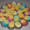 "2009 Easter : I colored the eggs while watching ""The Ten Commandments"" on TV. You know that is a 4 hour movie(!), which is about how long this process took. While I thought they were cute, colorful, and unique...I also decided to take plenty of pictures. Entertaining as the activity was, it may not happen again soon.  Gary's side of our family came for supper on Easter Sunday. The weather cooperated and we had enough food to send home leftovers. **Gary and Denny smoked 4 hams for Easter. Denny & Laura picked out a spiral cut ham, so the guys wrapped it with wire to hold it together while being smoked."