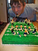 2010 Mark's Super Bowl Birthday Cake : Marcia baked and decorated this for Mark's Annual Super Bowl Birthday Party. She made the football players out of marzipan and handpainted them! We didn't make it up there, but we enjoyed these pictures she emailed.