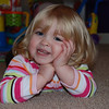 "2011 Riley at 25 Months : What a cute bundle of energy! Wish I could've captured her smile right after I tickled her, but I was too slow. At age 2, Riley can dribble and dunk the basketball; not so surprising since her Daddy coaches Girls' Basketball. She knows her ABC's, can count to 10, identify all the animals in her book, and imitate them. She enjoyed taking a few photos of her folks today. One thing Riley really doesn't do is sit still for long. Ha. She's ready to be ""Big Sister"" this summer, and no doubt will help Mommy with the twins :)"